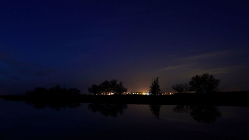 STOCKTON, CA - Feb. 25, 2016: Stars begin to shine after dusk on the Middle River in the Sacramento-