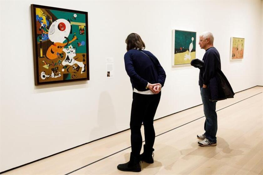 """Visitors observe the art pieces at New York's Museum of Modern Art (MoMA) during the exhibition of Spanish painter Joan Miro """"Joan Miro: Birth of the World,"""" on Feb. 21, 2019 in New York City, US. EPA-EFE/ Justin Lane"""