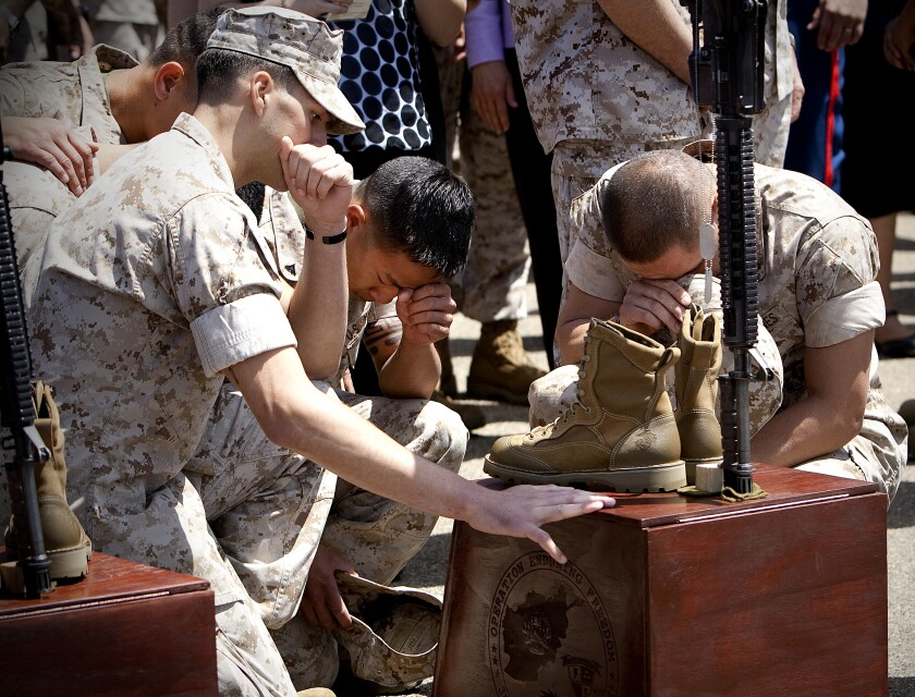 Marines from 3rd Battalion 5th Marines pay their final respect during a memorial service held on Camp Pendleton