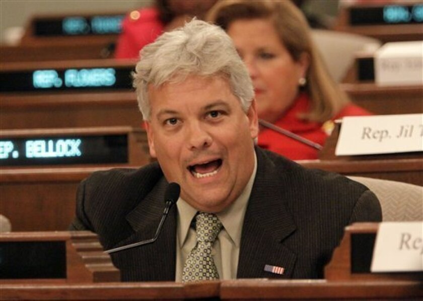 Rep. Jack Franks (D-Woodstock) votes to recommend the impeachment of Illinois Gov. Rod Blagojevich to the House during an Illinois House Impeachment Committee hearing Thursday, Jan. 8, 2009, in Springfield, Ill. The committee voted unanimously to recommend impeachment putting the matter before the