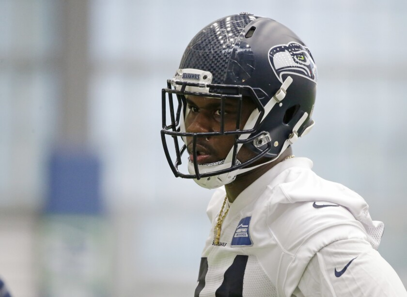 FILE - In this May 12, 2017, file photo, defensive tackle Malik McDowell, the Seattle Seahawks' top draft pick, watches a drill during NFL football rookie minicamp in Seattle. The Cleveland Browns are giving McDowell the chance to revive an NFL career stopped by some serious legal trouble. (AP Photo/Ted S. Warren, File)