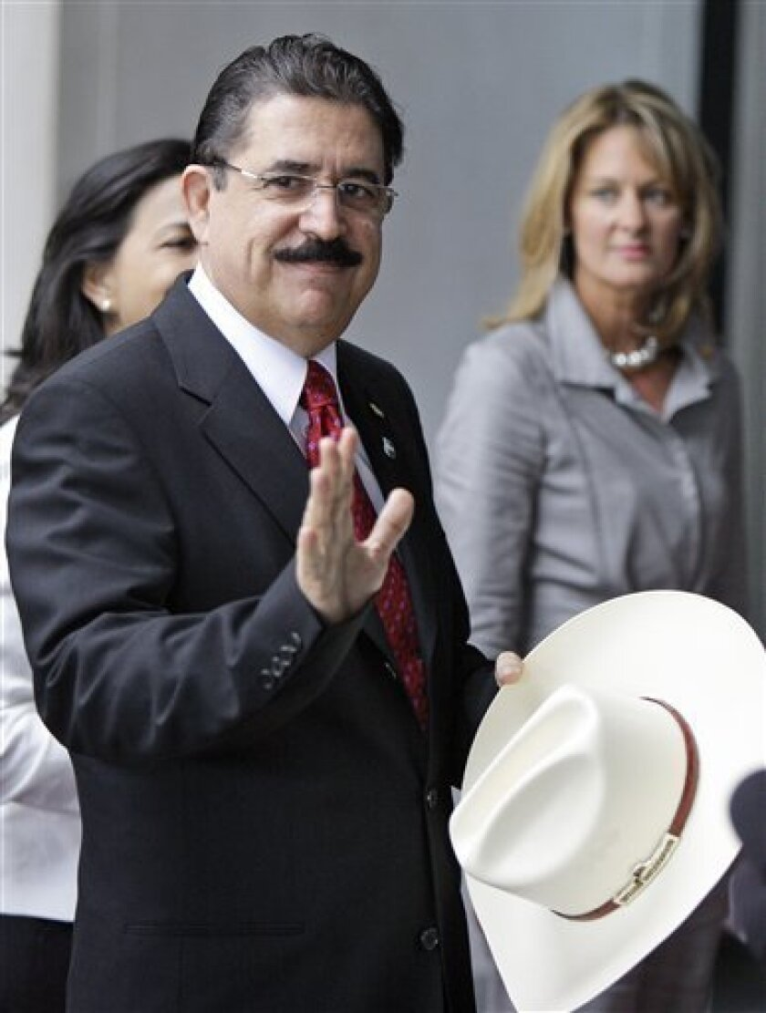Ousted Honduran president Manuel Zelaya arrives at the U.S. State Department for a meeting with Sec. of State Hillary Rodham Clinton in Washington Tuesday, July 7, 2009.(AP Photo/Alex Brandon)