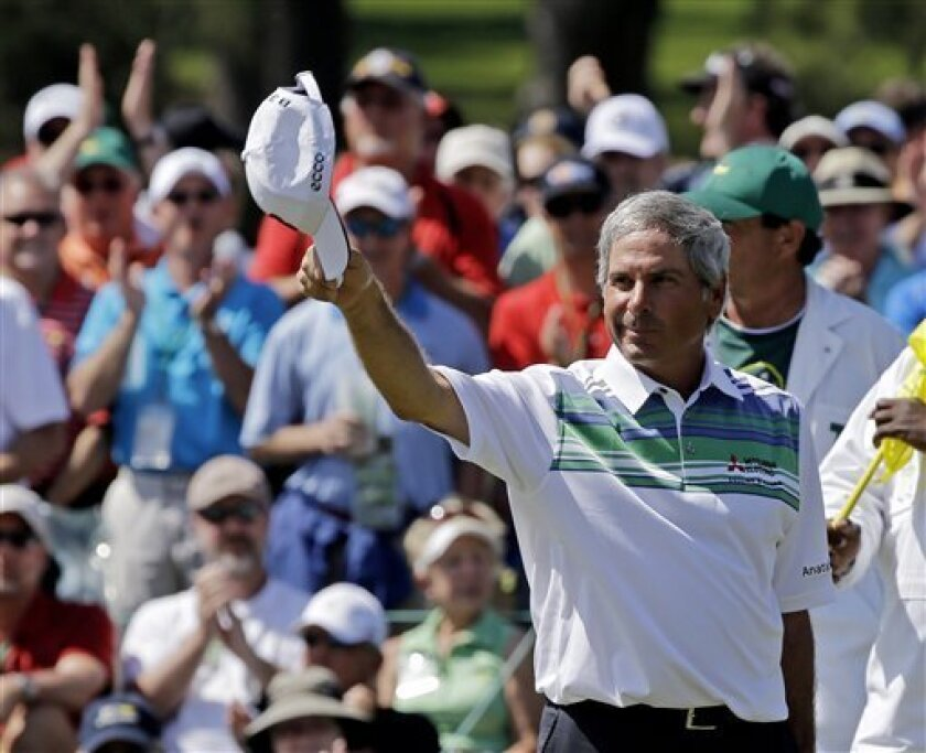 Fred Couples tips his cap after a birdie on the 18th green during the second round of the Masters golf tournament Friday, April 12, 2013, in Augusta, Ga. (AP Photo/David J. Phillip)