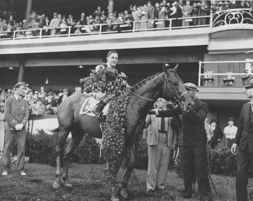 """Ira """"Babe"""" Hanford sits in the saddle atop 20-1 shot Bold Venture after receiving the victor's wreath in the 1936 Kentucky Derby in what was his only Run for the Roses appearance. Hanford was suspended for 15 days after the race, but says he was never told why."""