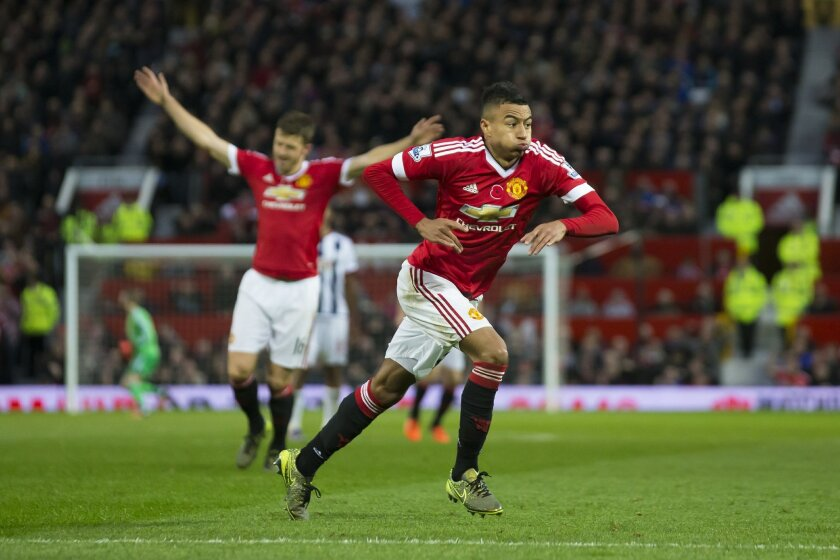 Manchester United's Jesse Lingard, right, celebrates after scoring during the English Premier League soccer match between Manchester United and West Bromwich Albion at Old Trafford Stadium, Manchester, England, Saturday, Nov. 7, 2015. (AP Photo/Jon Super)