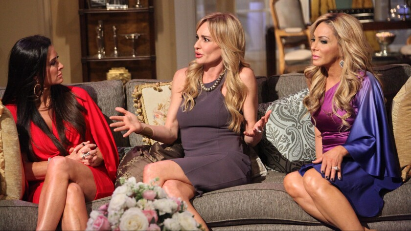 """Kyle Richards, left, Taylor Armstrong and Adrienne Maloof appear in Bravo's reality series """"The Real Housewives of Beverly Hills."""""""