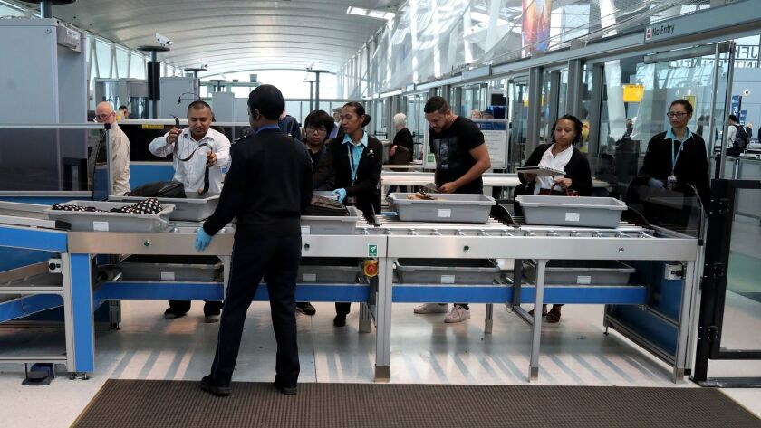 Passengers use a TSA checkpoint at John F. Kennedy International Airport in New York City on May 17.