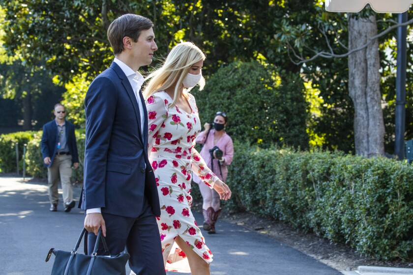 Ivanka Trump, right, daughter of and adviser to President Donald Trump, and White House senior adviser Jared Kushner walk on the South Lawn after they arrived with the president at the White House, Sunday, July 26, 2020, in Washington. (AP Photo/Manuel Balce Ceneta)