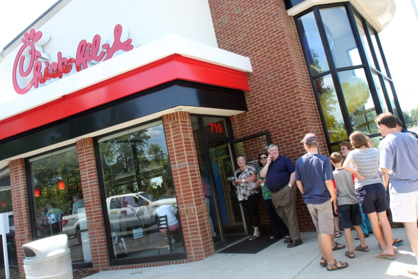 Customers wait in line outside a Chick-fil-A restaurant in Shelby, N.C., in 2012. Chick-fil-A's philanthropic arm will not donate to the Salvation Army or the Fellowship of Christian Athletes next year.