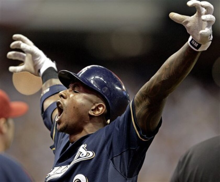 Milwaukee Brewers' Nyjer Morgan reacts after hitting a two-run scoring single during the sixth inning of Game 2 of baseball's National League division series against the Arizona Diamondbacks Sunday, Oct. 2, 2011, in Milwaukee. (AP Photo/David J. Phillip)