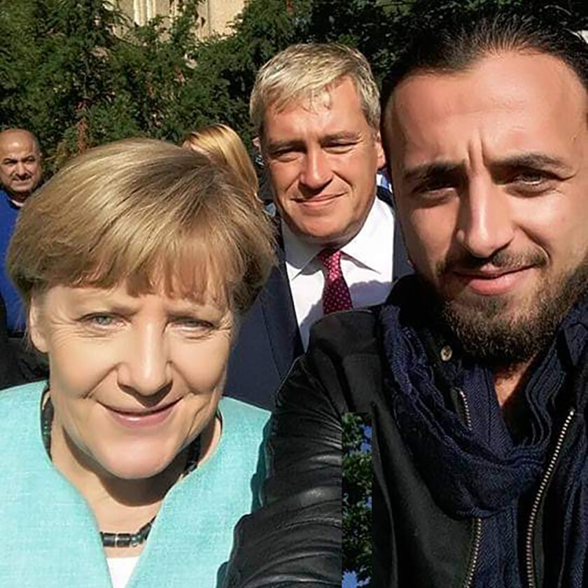 A selfie that Rodin Saouan took with German Chancellor Angela Merkel on Sept. 10, 2015.