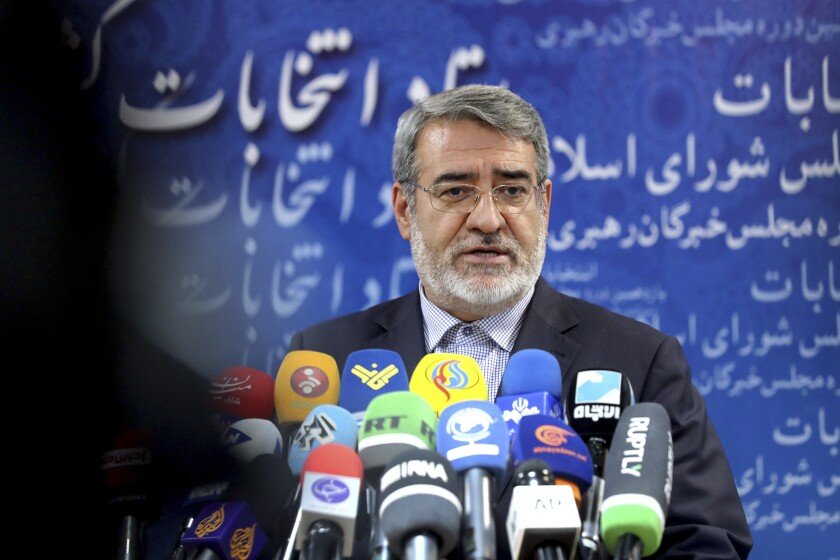 Iranian Interior Minister Abdolreza Rahmani Fazli speaks during a press conference at the interior ministry in Tehran, Iran, Sunday, Dec. 1, 2019. Iran has begun registration of candidates for running in the country's parliamentary elections set for February 2020, the official IRNA news agency reported on Sunday. (AP Photo/Ebrahim Noroozi)