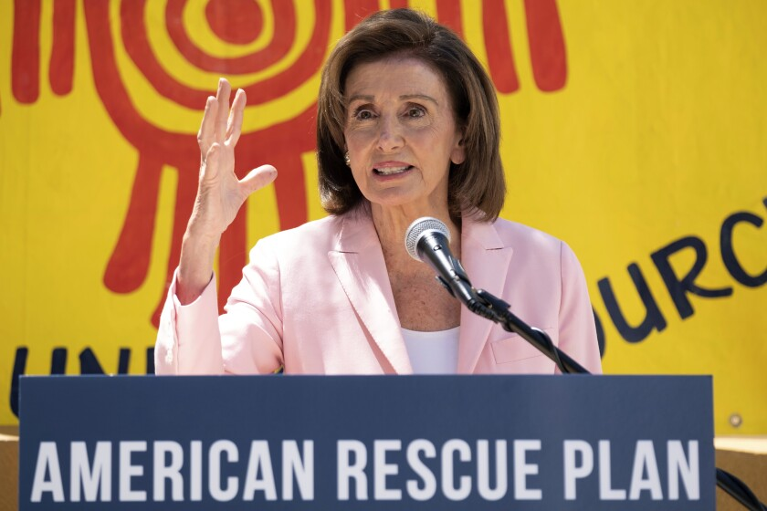 """FILE - In this Aug. 10, 2021, file photo House Speaker Nancy Pelosi speaks at a press event regarding the Emergency Rental Assistance program in San Francisco. Moderate House Democrats say they'll sink a crucial fiscal blueprint outlining $3.5 trillion in social and environment spending unless a separate infrastructure bill is approved first. Nine of them have written Pelosi saying they """"will not consider voting"""" for the budget resolution unless the separate, $1 trillion infrastructure measure is first enacted into law. (AP Photo/Nick Otto, File)"""