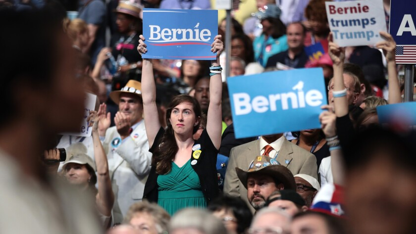 Supporters of Bernie Sanders hold up signs at the Democratic National Convention in Philadelphia.