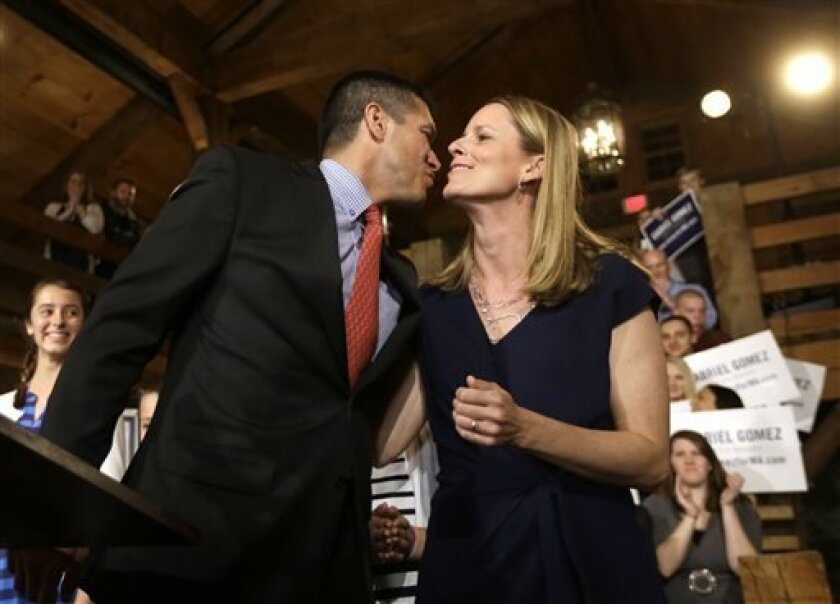 Republican candidate for the U.S. Senate Gabriel Gomez, left, kisses his wife, Sarah, as he takes to the stage before addressing an audience with a victory speech at a watch party, in Cohasset, Mass., Tuesday, April 30, 2013. Gomez won his primary bid for the Republican nomination to contest a U.S.