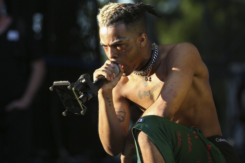 XXXTentacion performs at Miami's Rolling Loud Festival in 2017. The rapper was killed in South Florida on Monday afternoon.