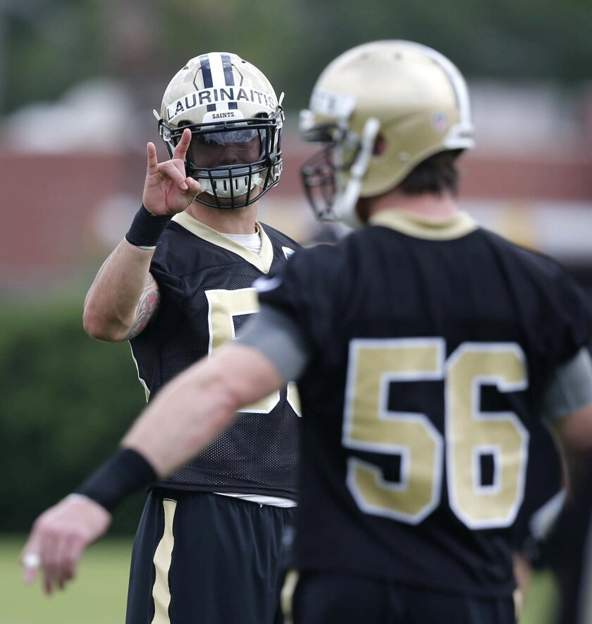 New Orleans Saints linebacker James Laurinaitis gives a signal to linebacker Michael Mauti (56) during NFL football practice in Metairie, La., Thursday, May 26, 2016. Stephone Anthony, a 2015 first-round pick who quickly took over as starting middle linebacker, is preparing for a position change. N