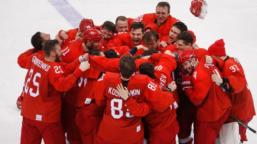 Olympic athletes from Russia celebrate after winning the men's gold medal hockey game against German