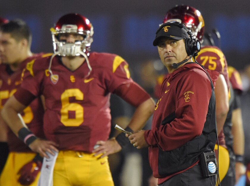 USC coach Steve Sarkisian, right, stands near quarterback Cody Kessler during the Trojans' game against UCLA. Four years ago, Sarkisian coached Washington to an upset win over Nebraska in the Holiday Bowl. (AP Photo/Mark J. Terrill)