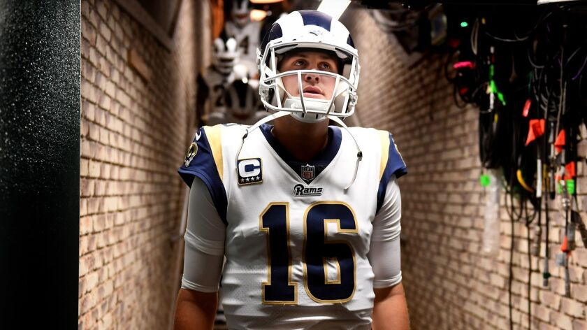 OAKLAND, CALIFORNIA SEPTEMBER 10, 2018-Rams quarterback Jared Goff wlaks through a tunnel to the fie