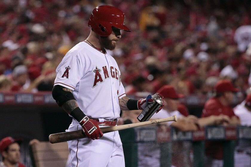 Josh Hamilton sprays his bat handle as he stands in the on-deck circle before batting in the second inning of Game 2 of the American League division series between the Angels and the Kansas City Royals on Oct. 3.