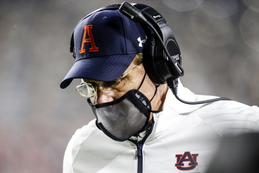 Auburn coach Gus Malzahn walks the sideline during the second half of the team's NCAA college football game against Arkansas on Saturday, Oct. 10, 2020, in Auburn, Ala. (AP Photo/Butch Dill)