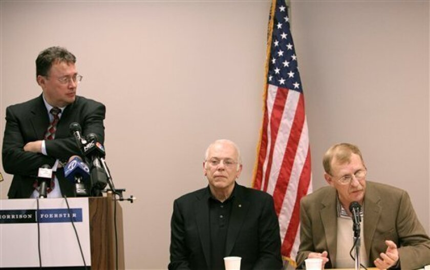Veterans Eric Muth, center, and Frank Rochelle, right, speak at a news conference as their attorney Gordon Erspamer, left, listens at the law offices of Morrison and Foerster in San Francisco, Wednesday, Jan. 7, 2009. Muth and Rochelle are among six veterans who claim they were unwittingly exposed
