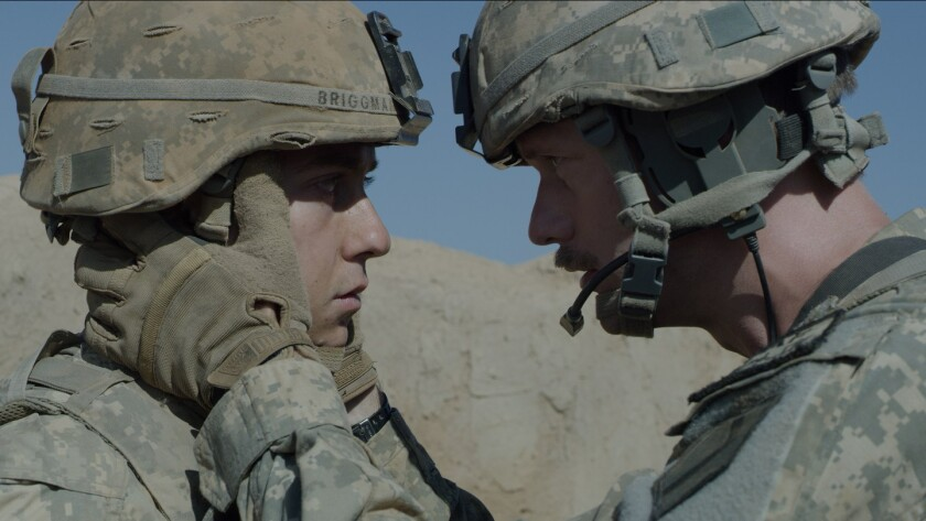 "Nat Wolff, left, and Alexander Skarsgard in the military survival ""The Kill Team."""
