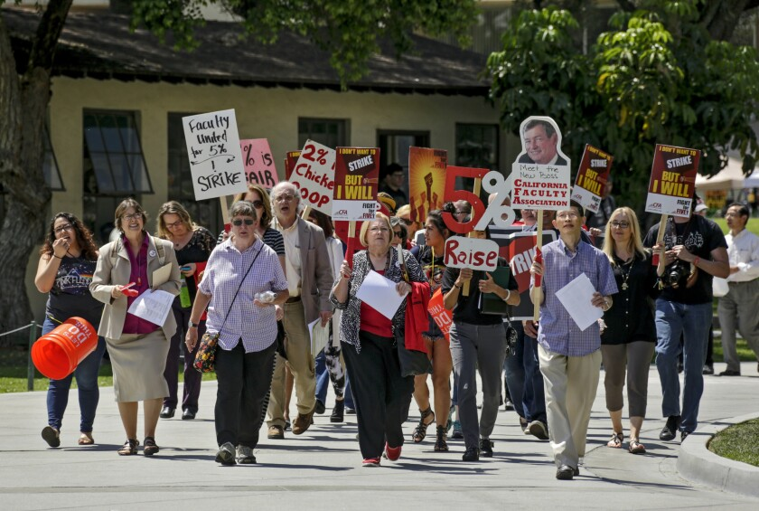 Faculty union members at Cal Poly Pomona, part of the Cal State system, practiced marching through campus in the days leading up to a scheduled strike last month. The strike was canceled after a last-minute deal was struck between union and university leaders.