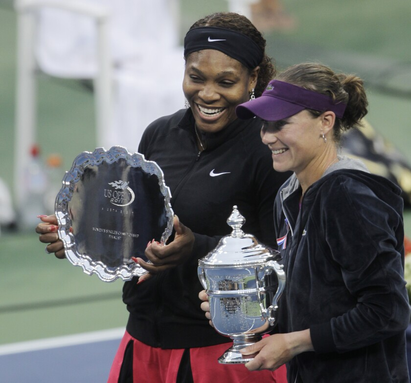 FILE - In this Sept. 11, 2011, file photo, Serena Williams, left, and Samantha Stosur, of Australia, pose with the trophies at the U.S. Open tennis tournament in New York. Stosur, the 2011 U.S. Open champion, is now a mom. The 36-year-old Australian tennis pro announced Monday, July 13, 2020, on Instagram that her partner, Liz, gave birth to a girl in June.(AP Photo/Mike Groll, File)