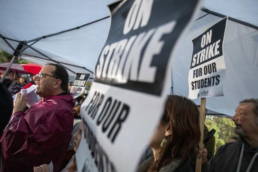 UTLA President Alex Caputo-Pearl, left, kicks off the LAUSD teachers' strike at John Marshall High School in Los Angeles.
