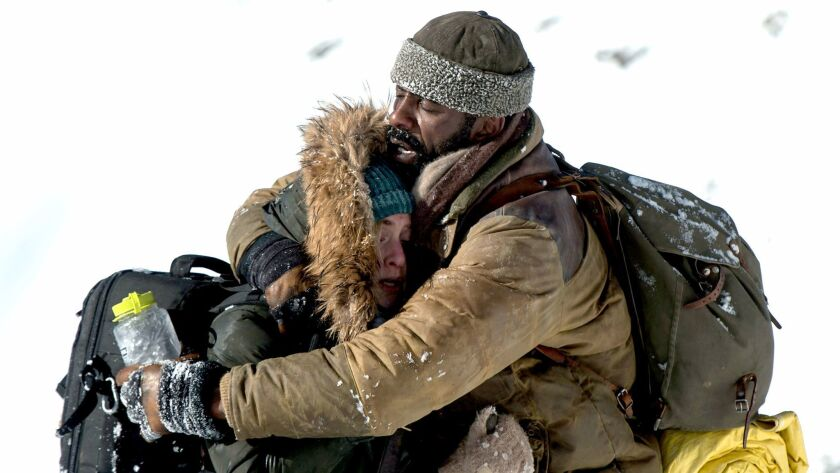 "Kate Winslet and Idris Elba star in Twentieth Century Fox's ""The Mountains Between Us."""