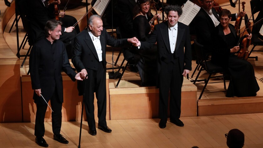 """Conductors Esa-Pekka Salonen, from left, Zubin Mehta and Gustavo Dudamel celebrate the Los Angeles Philharmonic's 100th birthday in a new episode of """"Great Performances"""" on PBS."""