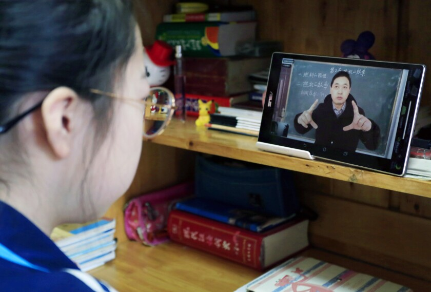 A student watches a teacher present a lesson virtually on Feb. 9  in Yuncheng, in the Shanxi province of China, in response to the rapidly spreading coronavirus.