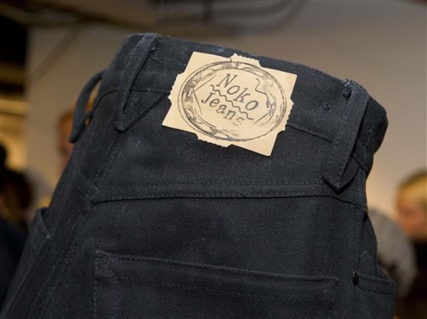 "The label on a pair of North Korea produced NoKo jeans is seen during the launch of the line of designer jeans at PUB department store in Stockholm, Sweden, Friday, Dec. 4, 2009. A trio of Swedish entrepreneurs launched a line of designer jeans made in North Korea, saying Friday they hope to help break the country's isolation by joining the handful of foreign manufacturers operating in the communist nation. ""Noko Jeans"" come in two models, the slim-fit ""Kara"" and the loose-fit ""Oke"" _ an apparent play on ""karaoke"" singing popular across Asia. The price tag is 1,500 kronor ($220) _ more than two years' wages for an average North Korean. (AP Photo/Scanpix/Jonas Ekstromer)"