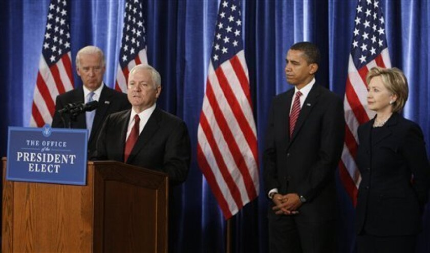 Defense Secretary Robert Gates, second left, speaks as Vice President-elect Joe Biden, left, President-elect Barack Obama; and Secretary of State-designate Hillary Rodham Clinton, far right, listen at a news conference in Chicago, Monday, Dec. 1, 2008. Gates, President Bush's Pentagon chief, will continue in that role in the new Obama administration. (AP Photo/Charles Dharapak)