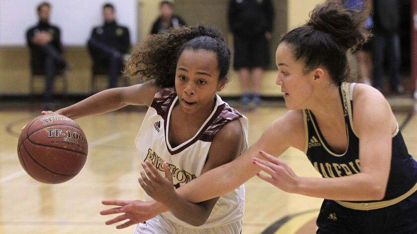 Bishop's Angie Robles, left, fights off La Costa Canyon's Katie Quain Friday at Bishop's. photo by B