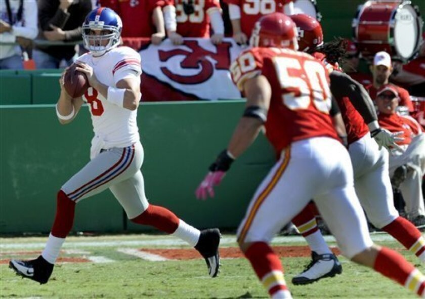 New York Giants quarterback David Carr, left, looks to throw as Kansas City Chiefs linebacker Mike Vrabel (50) defends during the fourth quarter of an NFL football game Sunday, Oct. 4, 2009, in Kansas City. The Giants won 27-16. (AP Photo/L.G. Patterson)