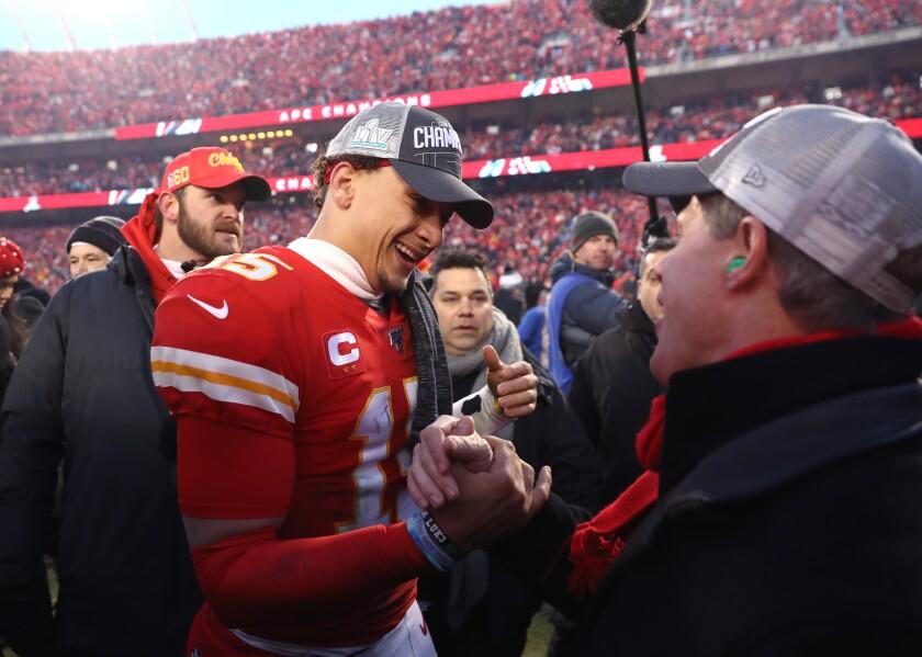 Chiefs quarterback Patrick Mahomes celebrates with team owner Clark Hunt.