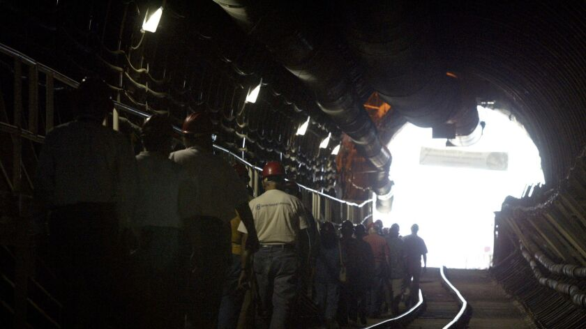 A group walks through the Yucca Mountain project site in Nevada in 2004.