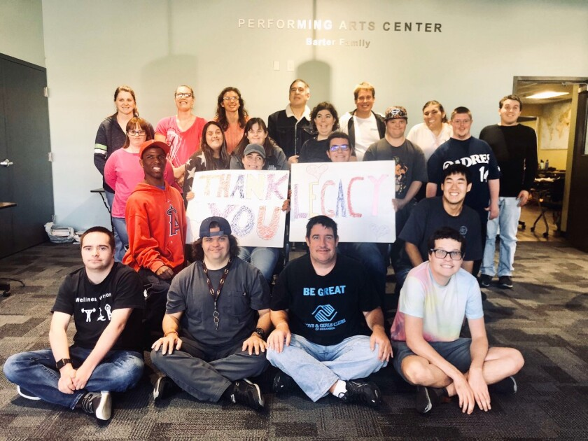 The Boys & Girls Clubs of Oceanside received a $4,500 grant from the Elisabeth Wilson Endowment, administered through the Legacy Endowment Community Foundation to support the R.O.A.D.'s program offered by the Club. The program provides opportunities for adults with intellectual or developmental disabilities to learn life skills through community involvement. Members participate in educational, social and life skill activities, including financial literacy and self-defense classes, yoga and Zumba along with volunteering at the local Senior Center, library and garden. Members have taken field trips to local theaters, Bates Nut Farm, Birch Aquarium and the San Diego Zoo. The group also puts on plays, most recently they performed in Beauty and the Beast. The grant funds will be used to purchase performing arts equipment, Wellness Warriors cooking equipment and exercise equipment. Pictured are R.O.A.D.'s participants and Club staff with a huge thank you card they made. Visit BGCOceanside.org