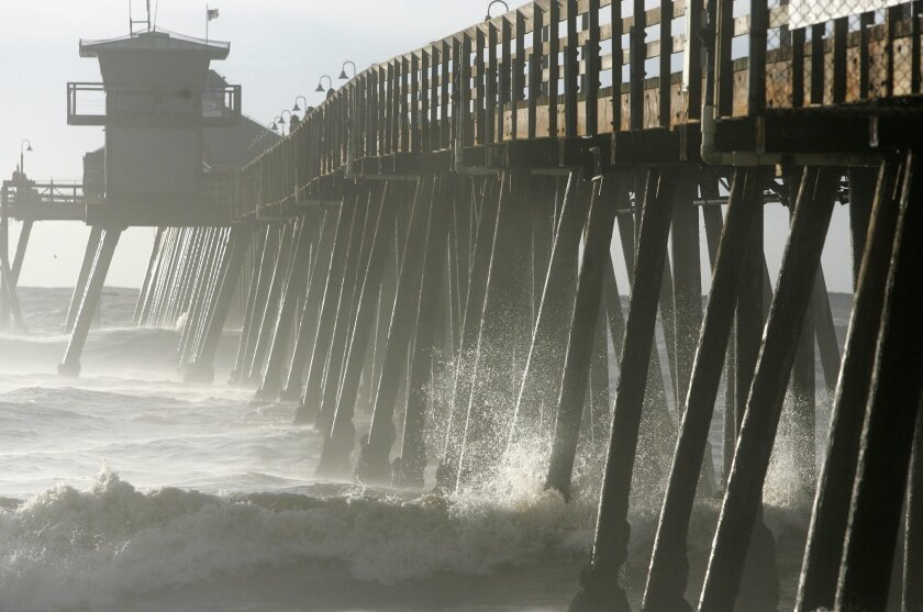 Unusually brown water near the Imperial Beach pier, shown here in a file photo, has mystified lifeguards. It's apparently not related to an oil sheen off the South County coastline over the weekend.