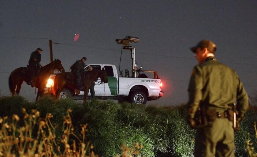 U.S. Border Patrol agents work along the Rio Grande near McAllen, Texas.