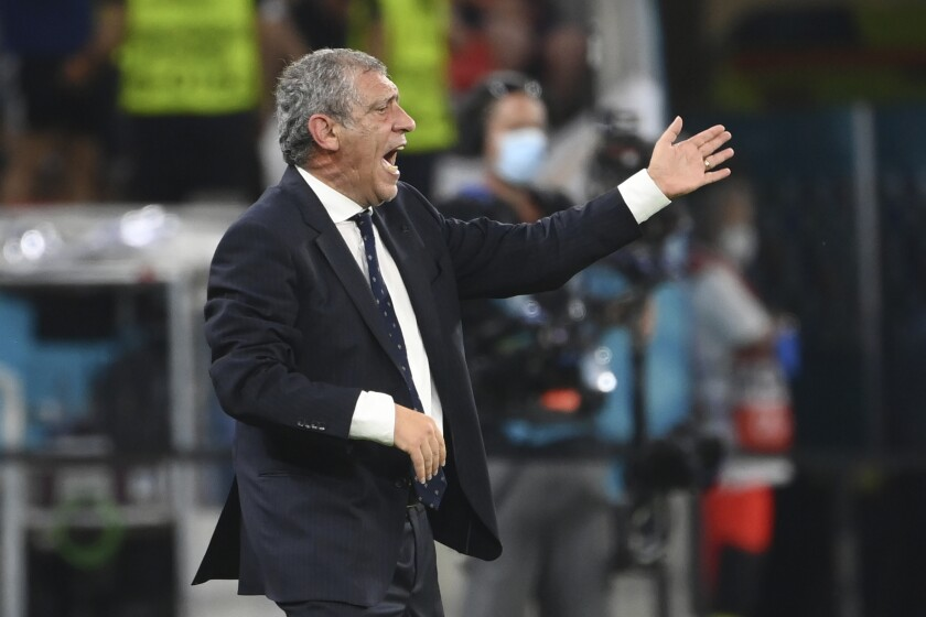 Portugal's manager Fernando Santos gestures during the Euro 2020 soccer championship group F match between Portugal and France at the Puskas Arena in Budapest, Wednesday, June 23, 2021. (Franck Fife, Pool photo via AP)