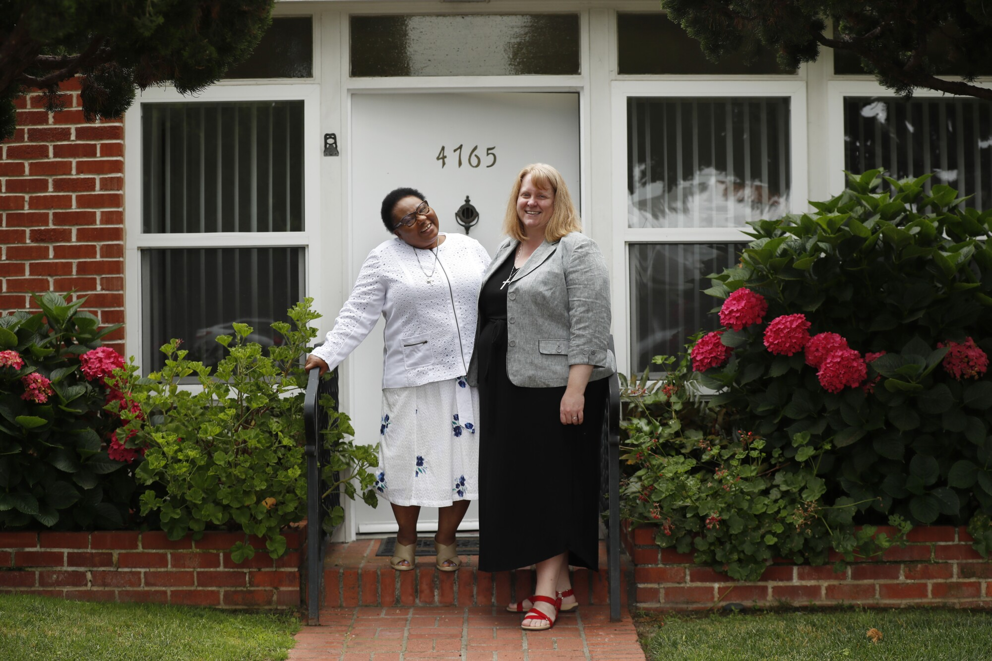 Sister Evelyn Uchenna Oluoha (left) and Sister Juliet Mousseau are nuns with the Society of the Sacred Heart.