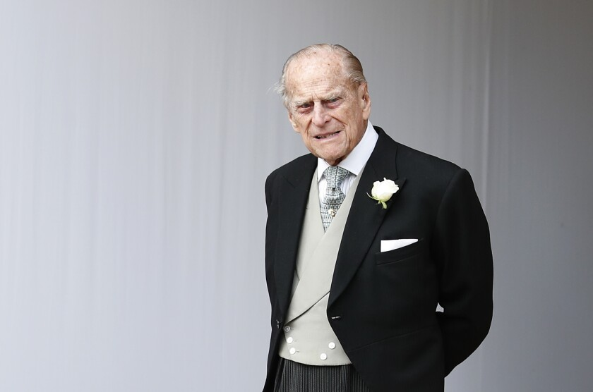 "Buckingham Palace says Prince Philip, seen at the 2018 wedding of Princess Eugenie of York, has been admitted to a London hospital ""as a precautionary measure."""
