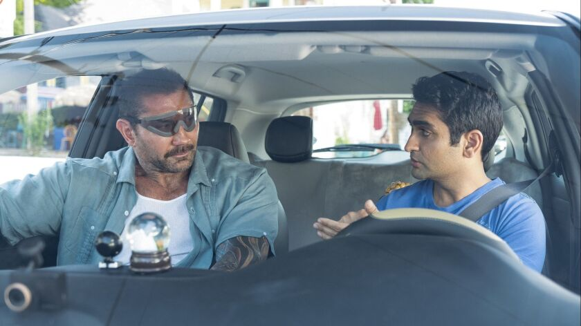 "Dave Bautista, left, and Kumail Nanjiani in the movie ""Stuber."""