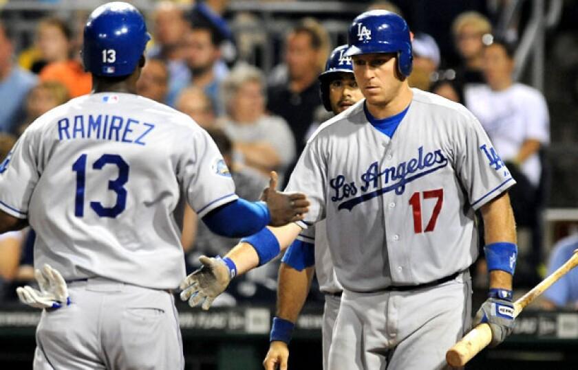 Dodgers catcher A.J. Ellis congratulates teammate Hanley Ramirez during a game against the Pirates last season.