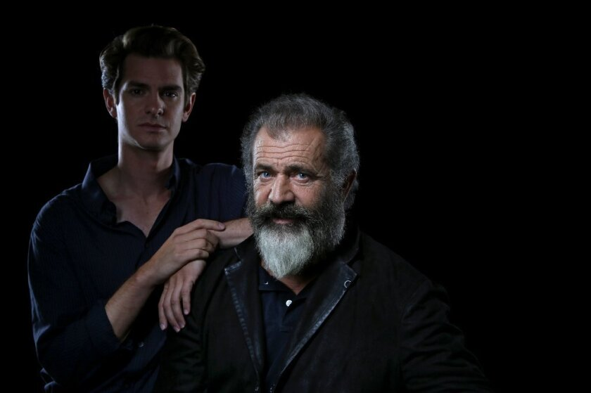 """Conscientious objector Desmond Doss risked his life to save others in WWII, """"the greatest act of love there is,"""" says director Mel Gibson, right, who tells Doss' story in """"Hacksaw Ridge,"""" starring Andrew Garfield."""