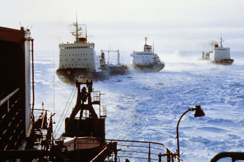 A convoy of Russian icebreakers clear a shipping lane through Arctic ice in January 2013. As melting ice opens access to Arctic shipping for longer periods each year, Canada has joined Russia and Denmark in pursuing the rights to maritime control and resource harvesting in the Arctic.